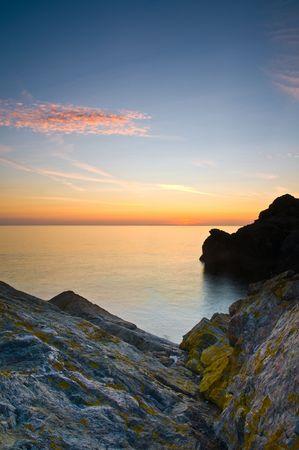 Sunrise of the rugged Cornish coast in England, UK.