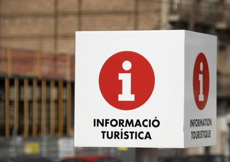 A Tourist Information sign captured in Barcelona, Spain.