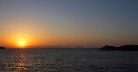 This beautiful sunset was photographed from the town of Korissia on the Greek island of Kea. Stock Photo