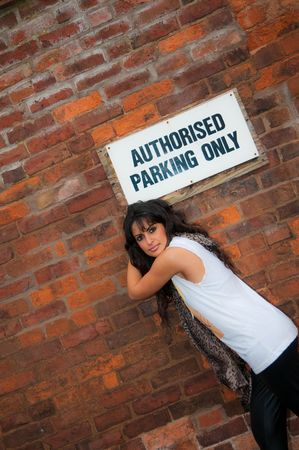 An attractive young Asian women in a city centre office car park. Stock Photo - 4204283