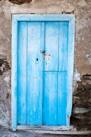 An old blue door on a dissused building in Greece.