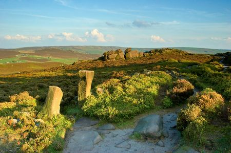 viewpoint: Two standing stone gateposts lead into the view beyond Doxey Pool on top of The Roaches. The Peak District, England, UK.