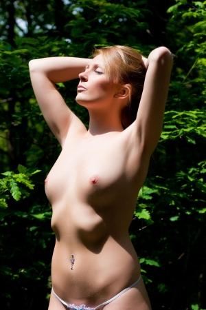 A sexy young woman enjoying the sun. Stock Photo
