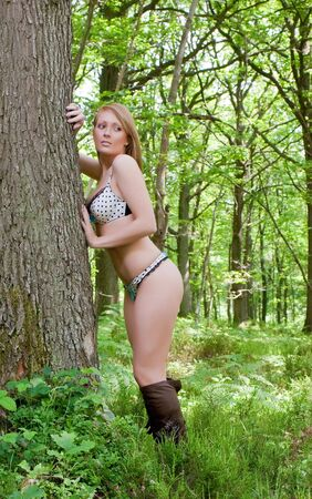 A young woman out alone in the forest. Stock Photo