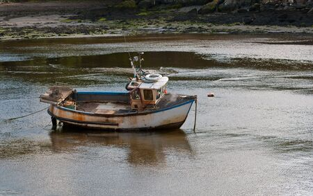 A small fishing boat in the harbour at Milford Haven, Wales.
