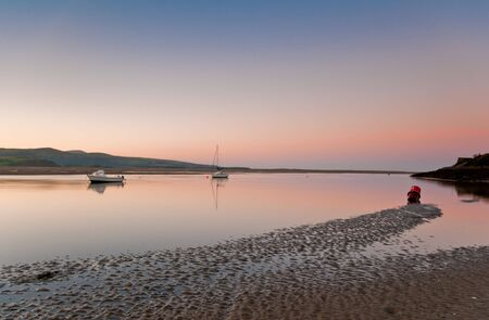 Moored boats captured at daybreak in Borth-Y-Gest, Wales, UK.