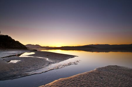 Sunrise over the ocean at Borth-Y-Gest, Wales, UK.