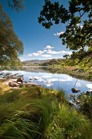 The calm waters of Llyn Dinas in summertime.