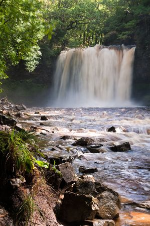Sgwd yr Eira in the Brecon Beacons National Park, Wales. Running at full flow after heavy rain