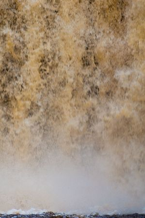 A close in shot of a waattrfall in full flow after heavy rain.
