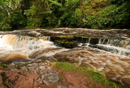 The river Mellte in full flow after a period of heavy rainfall. Stock Photo