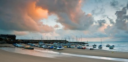 New Quay harbour in West Wales, captured in dawn light. Stock Photo