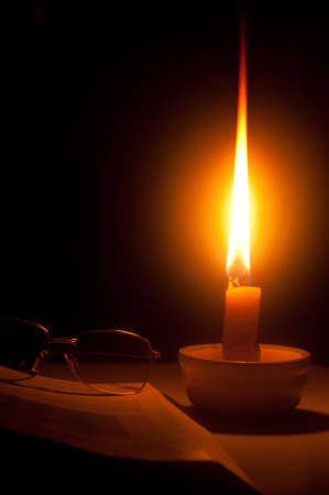 In a black out night, candle can bring light to poeple and learning life can go on. photo