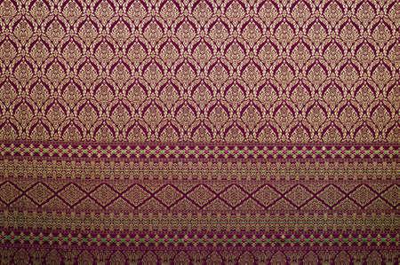Handmade Thai silk fabric with Thai design photo