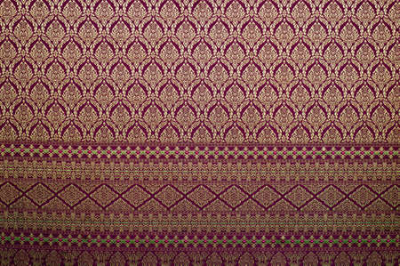 silk thread: Handmade Thai silk fabric with Thai design Stock Photo