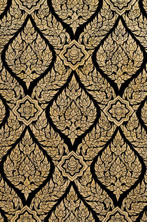 symetric: Old Thai design using gold on black adhesive from trees Stock Photo