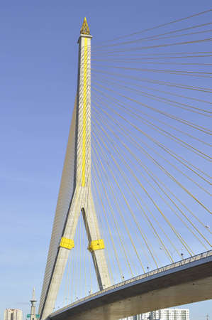 Main pillar and cablings of the Rama VIII bridge in a bright morning day, Bangkok, Thailand photo