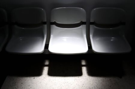 unoccupied: Unoccupied poly chair with point light Stock Photo