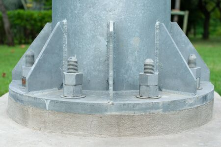 Double nut fastening technique to prevent loosen in post or long structure assembly