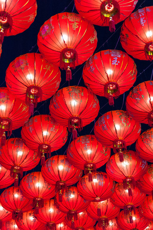 malaysia culture: Chinese red lanterns hanging in street at night for decoration during the Chinese New Year festival at Chinatown, Ratchaburi, Thailand Chinese Red lanterns illuminated at night Stock Photo