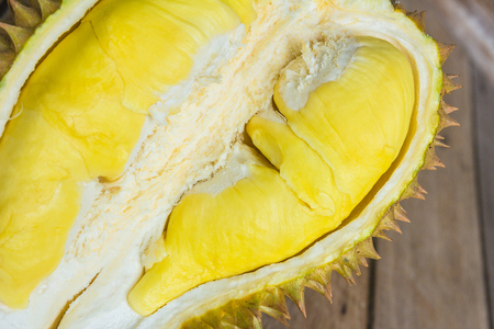 Fresh Cut Kanyao Durian on wooden background,a close-up view of DurianYellow durian inside Mon Thong durian, King of fruit  durian and durian peeled fruit plate tropical durian