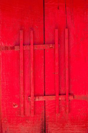 Red door of church with wood latch Thai traditional style, antique wooden door Buddhist temple gate with wooden door red color vintage style Standard-Bild
