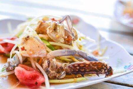 Som tum or Spicy papaya salad with raw blue crab (som tum poo ma)Thai food - green papaya salad with mixed dried shrimp or dried salted prawn (som tum thai)