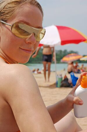 woman holding sunscreen photo