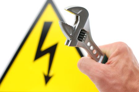 high voltage sign and spanner photo