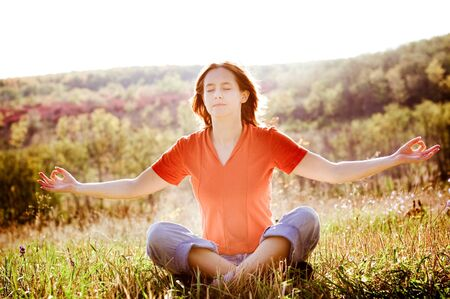 attractive woman practicing yoga outdoors Stock Photo - 4406819