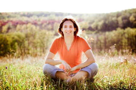 attractive woman practicing yoga outdoors Stock Photo - 4406821