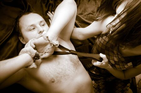 young couple with the handcuffs