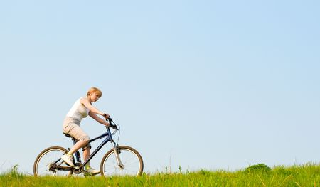 girl relax biking on green grass