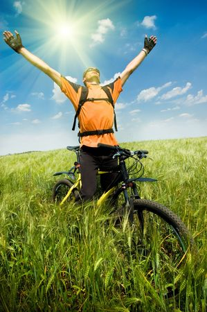 adventure sports: biker in green summer field