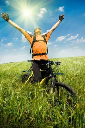 extreme sport: biker in green summer field