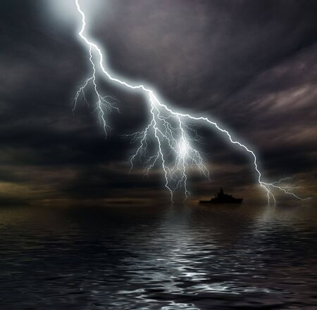 Dark stormy clouds over the ocean  photo