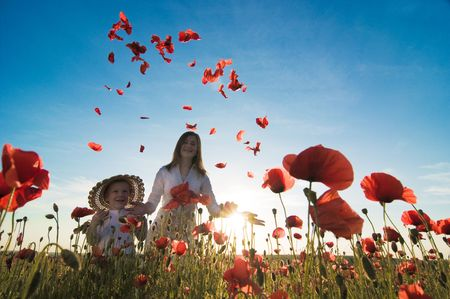 mother and son in poppy field Stock Photo - 5159762