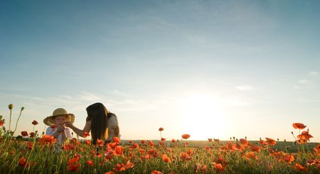 mother and son in poppy field photo