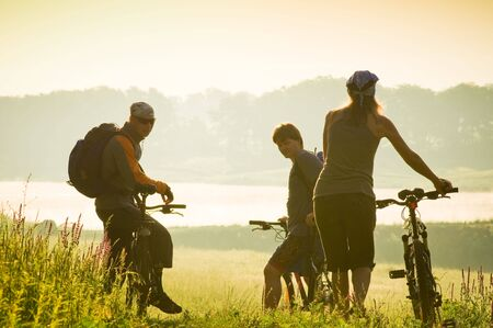 mixed group of cyclists at sunset Stock Photo - 5159729
