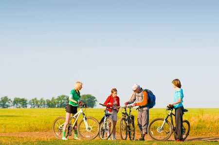mixed group of cyclists in field Stock Photo - 5159718