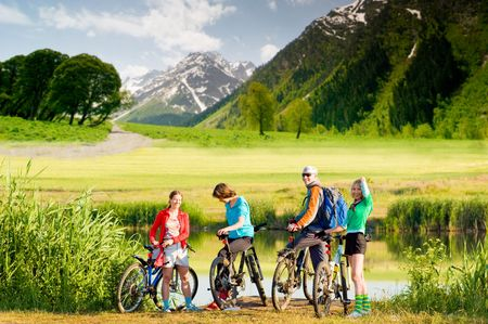 adventure holiday: mixed group of cyclists  outdoors  Stock Photo