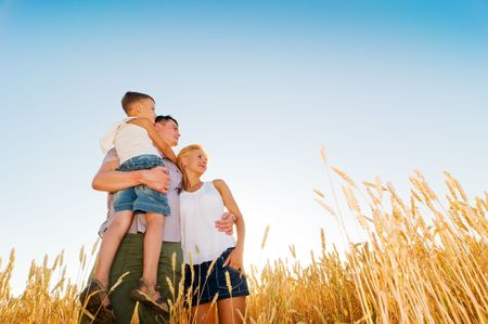 wheat fields: happy family having fun outdoors
