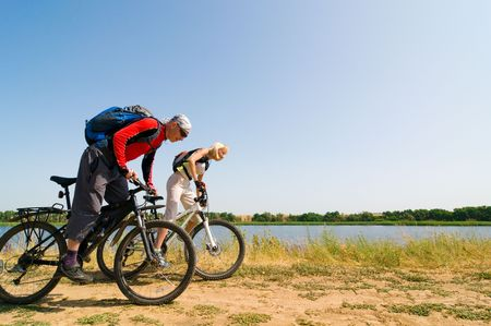 lifestile: two cyclists relax biking outdoors