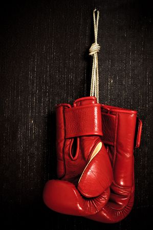 boxing-glove hanging on grunge background Stock Photo