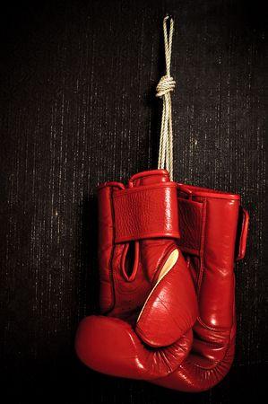 boxing glove: boxing-glove hanging on grunge background Stock Photo