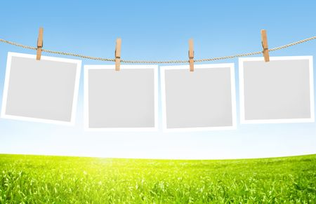 polaroids: Blank paper sheets on a clothes line Stock Photo