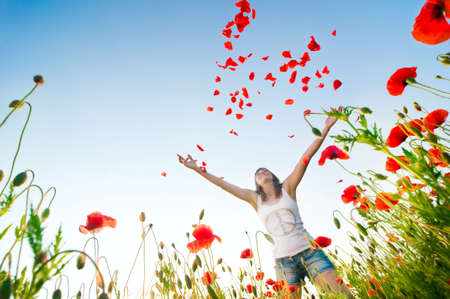 girl stands in poppy field Stock Photo - 5553190