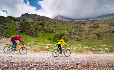 two cyclists relax biking outdoors Stock Photo - 5553202