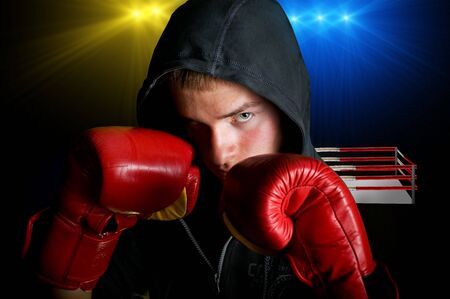 boxing boy: young boxer with ring background Stock Photo