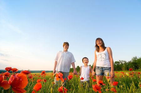family in red poppy field Stock Photo - 5706256